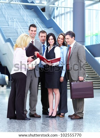Group of business people in the modern urban hall. - stock photo