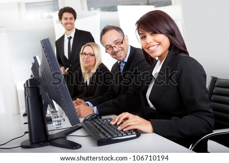 Group of business people in the office working on computers