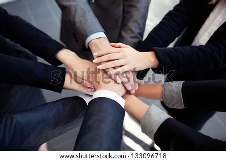 Group of business people joining hands. - stock photo