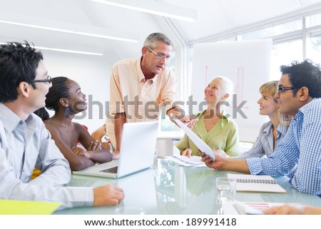 Group of Business People Learning With the Help of Their Mentor - stock photo