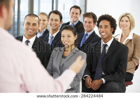 Group Of Business People Listening To Speaker Giving Presentation - stock photo