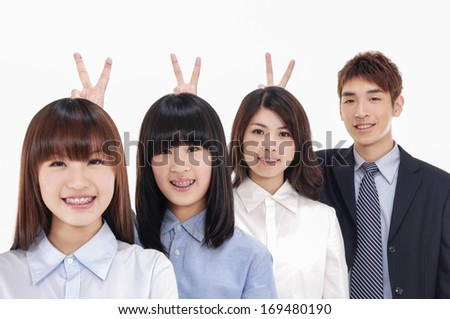 group of business people looking at camera with smiles and showing sign of victory - stock photo