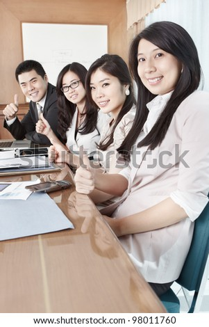 Group of business people looking to the camera - stock photo