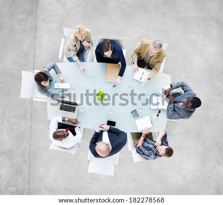 Group Of  Business People Meeting at Conference Table - stock photo