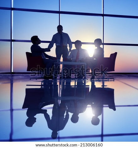 Group of Business People Meeting in Back Lit - stock photo