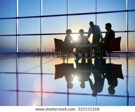 Group of Business People Meeting in Back Lit Concept - stock photo