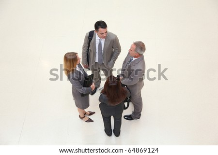 Group of business people meeting in hall - stock photo