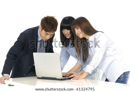 Group of business people on a laptop in an office