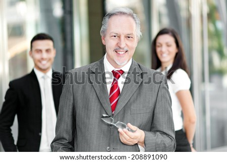 Group of business people outdoor - stock photo