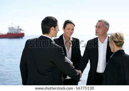 Group of business people shaking hands - stock photo
