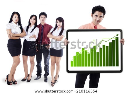 Group of business people showing the growth graph on a banner - stock photo