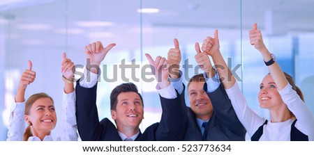 Group of business people showing thumbs up.