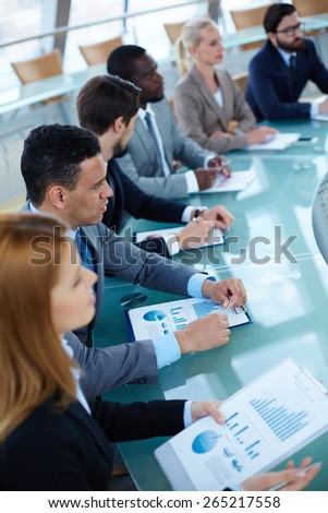 Group of business people sitting at seminar - stock photo