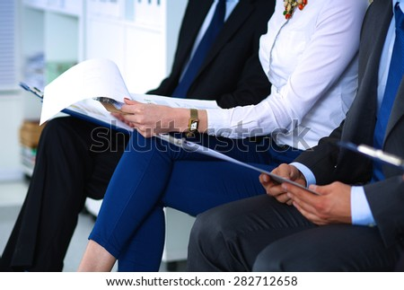 Group of business people sitting on chair in office - stock photo