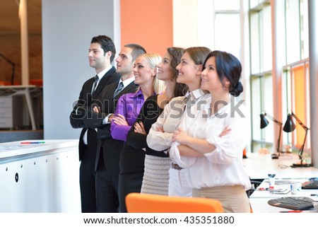 group of business people smiling in an office lined up - stock photo