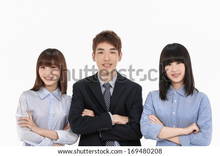 group of business people smiling with crossed arms - stock photo