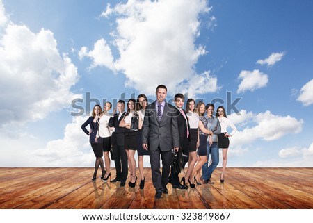 Group of business people stand on the wood floor under clouds sky.