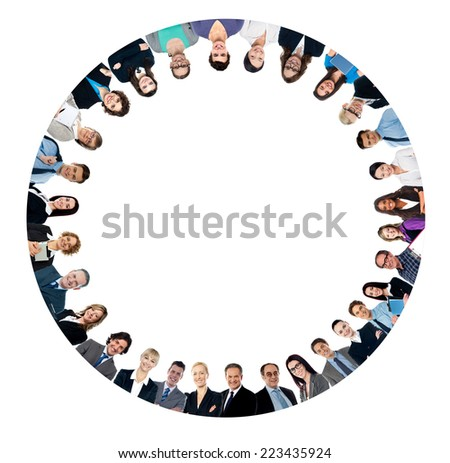 Group of business people standing in huddle, low angle view