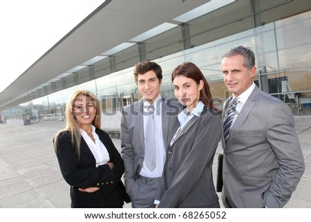 Group of business people standing outside building