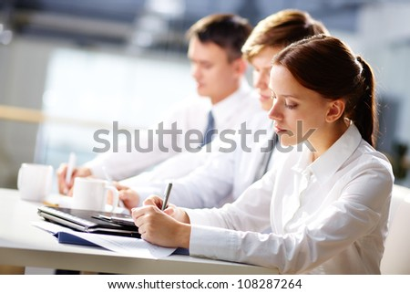 Group of business people taking notes at training - stock photo