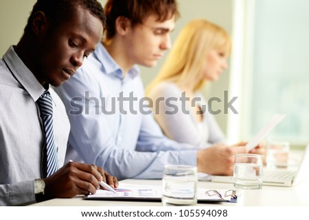 Group of business people taking their everyday work seriously - stock photo