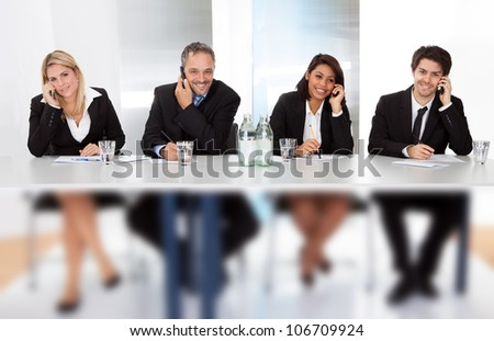 Group of business people talking on the phones at the meeting - stock photo