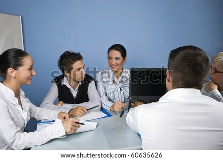 Group of business people using a laptop during a meeting,they having fun and discussion together - stock photo