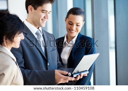 group of business people using laptop - stock photo