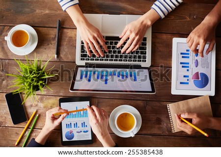 Group of business people using modern gadgets - stock photo
