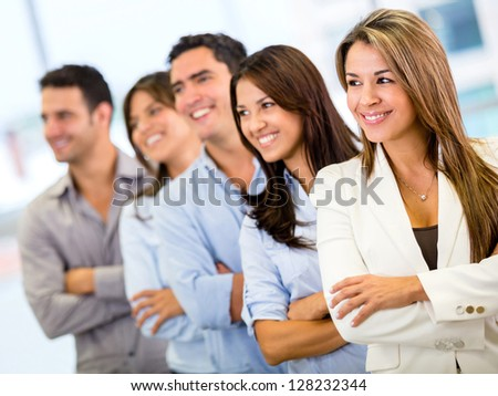 Group of business people with arms crossed at the office