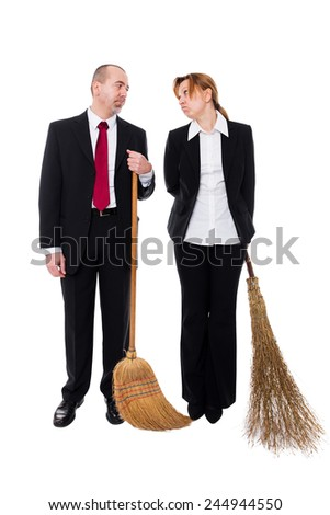 group of business people with brooms making a inappropriate working - stock photo