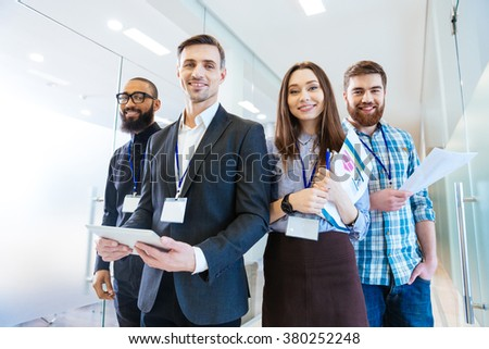 Group of business people with team leader standing in office - stock photo