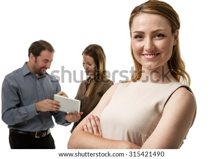 group of business people with the female standing in front - stock photo