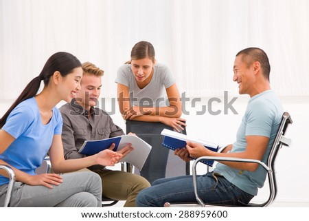 Group of business people working and discussing together office - stock photo