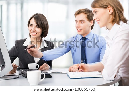 Group of business people working at the office - stock photo