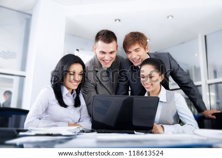 Group of business people working on laptop, looking at screen meeting at office desk work together, businesspeople colleague team sitting using computer discussing report