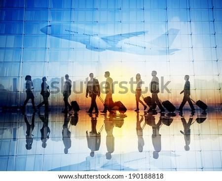 Group of Business Travellers Walking in an Airport - stock photo