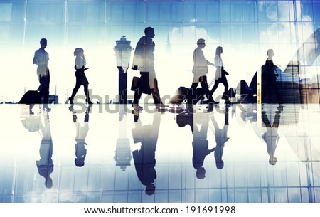 Group of Business Travellers Walking in the Airport  - stock photo