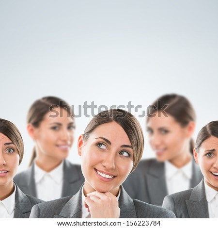 Group of business women clones with different emotions - stock photo