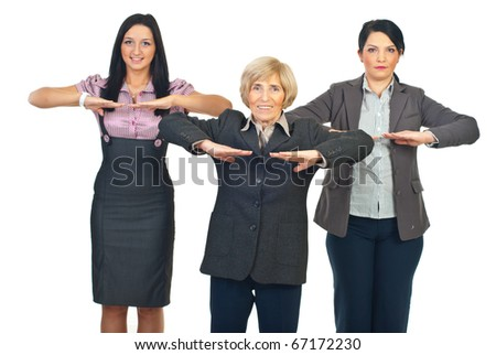 Group of business women doing fitness before starting their work isolated on white background - stock photo