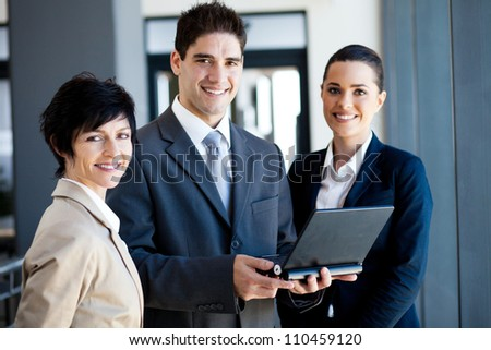 group of businessman and businesswoman portrait with laptop - stock photo
