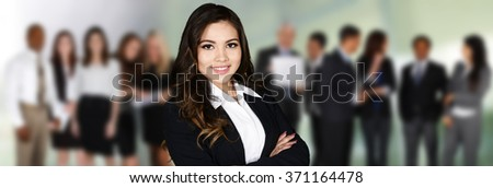 Group of businessmen and women working together - stock photo