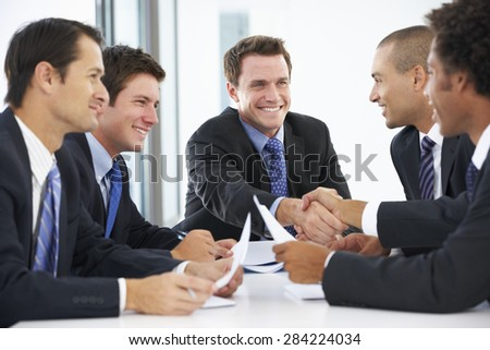 Group Of Businessmen Having Meeting In Office