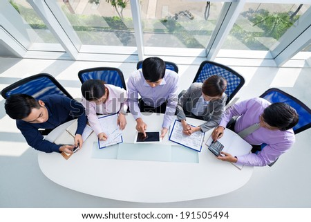 Group of businesspeople getting ready to the meeting, view from the top - stock photo