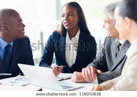 group of businesspeople having a meeting in modern office - stock photo