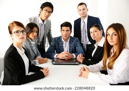 Group of businesspeople having meeting in the office - stock photo