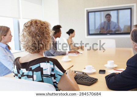 Group Of Businesspeople Having Video Conference In Boardroom - stock photo