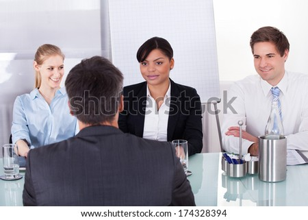 Group Of Businesspeople In Meeting At Conference Table - stock photo