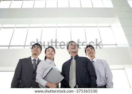 Group of Businesspeople Looking Away - stock photo