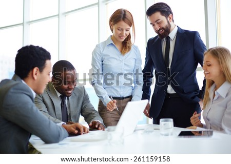 Group of businesspeople meeting in boardroom - stock photo